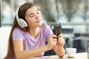 Relaxed teen listening to music in a bar